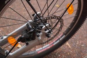Rear wheel of a Kickbike footbike showing the brake.
